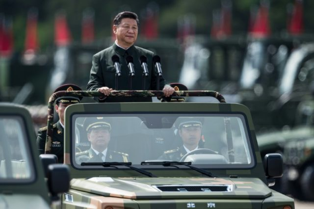 President Xi Jinping wore a Mao suit as he was driven in an open-top jeep past serried ranks of the People's Liberation Army, in a rare show of force in Hong Kong