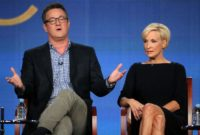 Joe Scarborough and co-host Mika Brzezinski on a 'Morning Joe' discussion panel in 2012
