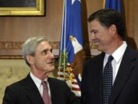 FILE - In this Sept. 4, 2013, file photo, then-incoming FBI Director James Comey talks with outgoing FBI Director Robert Mueller before Comey was officially sworn in at the Justice Department in Washington. Mueller, the somber-faced and demanding FBI director who led the bureau through the Sept. 11 attacks, and …