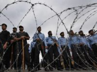 Pakistani police officers stand guard behind barbed wire to stop Shiite Muslims advancing toward the presidency, during a rally to condemn last weeks twin bombings in Parachinar, the center of Kurram region, in Islamabad, Pakistan, Wednesday, June 28, 2017. Battered by bombings that have killed scores of people, Pakistan's tribal …