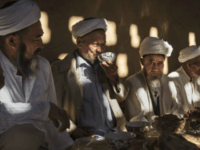 TURPAN, CHINA - SEPTEMBER 13: (CHINA OUT) Uyghur men gather for a holiday meal during the Corban Festival on September 13, 2016 in Turpan County, in the far western Xinjiang province, China. The Corban festival, known to Muslims worldwide as Eid al-Adha or 'feast of the sacrifice', is celebrated by …