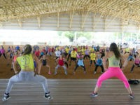 Zumba Fitness instructors Andrea Ceballos, left, and Michelle Donoso, right, lead a crowd in a workout during a Fitness Dance Party, Saturday, July 25, 2015, at Tropical Park in Miami. The event promoted health and fitness activities as part of Miami-Dade County's Park and Recreation Month. (AP Photo/Wilfredo Lee)