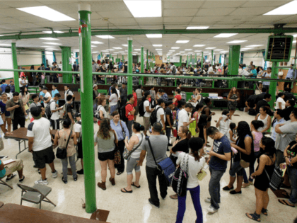 New York's Lower East Side, Wednesday, Aug. 15, 2012. Younger illegal aliens gather to get a work permit under a new government program.