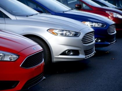 FILE - In this Thursday, Nov. 19, 2015, file photo, a row of new Ford Fusions are for sale on the lot at Butler County Ford in Butler, Pa. Ford Motor Co. has built the midsize Fusion sedan at its plant in Hermosillo, Mexico, since its introduction in 2005. (AP …