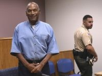 Former NFL football star O.J. Simpson enters for his parole hearing at the Lovelock Correctional Center in Lovelock, Nev., on Thursday, July 20, 2017. Simpson was convicted in 2008 of enlisting some men he barely knew, including two who had guns, to retrieve from two sports collectibles sellers some items …
