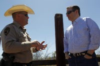 Cochise County Sheriff Mark Dannels speaks with Republican presidential candidate Sen. Ted Cruz, R-Texas, during a visit to the Arizona border with Mexico in Douglas, Ariz., Friday, March 18, 2016. (AP Photo/Ricardo Arduengo)