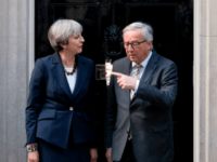European Commission President, Jean-Claude Juncker (R) and British Prime Minister Theresa May pose for a photograph outside 10 Downing Street in London on April 26, 2017.