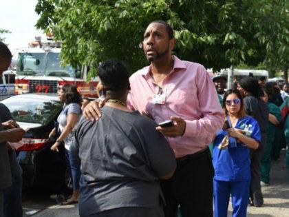 A man reacts outside the Bronx-Lebanon Hospital as police respond to an active shooter New York's Bronx borough