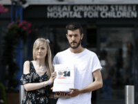 Connie Yates (L) and Chris Gard, parents of terminally-ill 10-month-old Charlie Gard, pose with a petition of signatures supporting their case, prior to delivering it to the Great Ormond Street Hospital for Children in central London on July 9, 2017.
