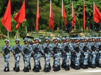 Members of Chinese People's Liberation Army based at the Hong Kong garrison march following Chinese President Xi Jinping's review in Hong Kong on June 30, 2017. Xi toured a garrison of Hong Kong's People's Liberation Army garrison as part of a landmark visit to the politically divided city. Anthony WALLACE …