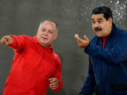 Venezuelan President Nicolas Maduro (R) talks with congressman Diosdado Cabello upon their arrival at the swearing in of the the members of the campaign command for the constituent assembly, in Caracas on May 29, 2017. Maduro has launched steps to set up a constituent assembly which the opposition says he …