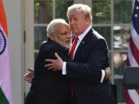 Donald Trump Narendra Modi hug (Nicholas Kamm / AFP / Getty)