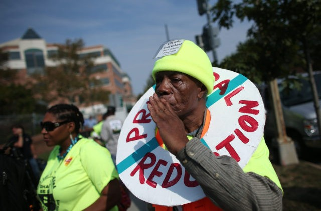 WASHINGTON, DC - SEPTEMBER 27: Protesters gather outside of Fannie Mae headquarters September 27, 2012 in Washington, DC. The protesters from various groups including Right to the City, the Home Defenders League, Occupy Our Homes, and Alliance for a Just Society met to protest against home foreclosures and to demand …