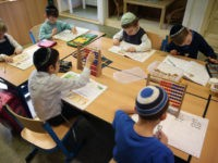 BERLIN, GERMANY - NOVEMBER 08: Jewish children attend a first grade math class at the Or Avner traditional Jewish school during a visit by Ashkenazi Chief Rabbi of Israel David Lau on November 8, 2013 in Berlin, Germany. A recent study released by the European Union Fundamental Rights Agency concludes …