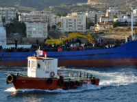 A Turkish Cypriot authority rescue vessel sails towards a fishing boat crammed with some 220 Syrian migrants near the port of Kyrenia off the northern coast of the Turkish Republic of Northern Cyprus, which is recognised only by Turkey, after the vessel hit rough seas in the Mediterranean on November …