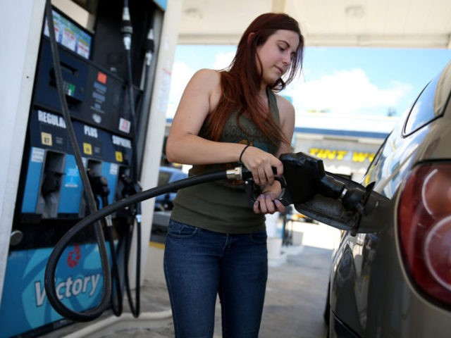 PEMBROKE PINES, FL - APRIL 21: Gabrielle Smith pumps gas at the Victory gas station on April 21, 2014 in Pembroke Pines, Florida. According to the Lundberg Survey the average price for a gallon of regular gas is now $3.69- the highest price since March of last year. (Photo by …