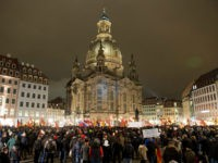 Supporters of the anti-immigrant Pegida movement (Patriotic Europeans Against the Islamisation of the Occident) mark the second year of existence as they demonstrate in Dresden, eastern Germany, on October 2016, and Dresden, a Baroque city in Germany's ex-communist east, is the birthplace of the anti-immigration PEGIDA street movement. / AFP …