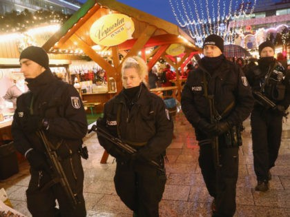 BERLIN, GERMANY - DECEMBER 22: Heavily-armed police walk through the reopened Breitscheidplatz Christmas market where three days ago a truck plowed into the market, killed 12 people and injured dozens in a terrorist attack on December 22, 2016 in Berlin, Germany. The Breidscheidplatz Christmas market is reopening today, though its …