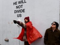 US actor Shia LaBeouf(L) during his He Will Not Divide Us livestream outside the Museum of the Moving Image in Astoria, in the Queens borough of New York January 24, 2017 as a protest against President Donald Trump. (TIMOTHY A. CLARY/AFP/Getty Images)