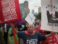 CHICAGO, IL - MAY 23: Demonstrators fighting for a $15-per-hour minimum wage march through downtown during rush hour on May 23, 2017 in Chicago, Illinois. The march was held to coincide with McDonald's shareholders meeting which will be held tomorrow in nearby Oak Brook. (Photo by Scott Olson/Getty Images)