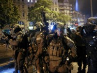 A police special commandos unit SEK patrol during riots on July 7, 2017 in Hamburg, northern Germany, where leaders of the world's top economies gather for a G20 summit. Protesters clashed with police and torched patrol cars in fresh violence ahead of the G20 summit, police said. German police and …