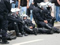 Police rest during a demonstration on July 8, 2017 in Hamburg, northern Germany as world leaders meet during the G20 summit. Raging street battles that marred Germany's G20 summit have sparked a political fight over how Hamburg could descend into 'mob rule' and why Chancellor Angela Merkel chose a hotbed …