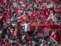 "ISTANBUL, TURKEY - JULY 09: Thousands of supporters cheer and wave flags while listening to Turkey's main opposition Republican People's Party (CHP) leader Kemal Kilicdaroglu speak on stage during the ""Justice Rally"" on July 9, 2017 in Istanbul, Turkey. The Justice Rally was held to conclude the 25 day ""Justice …"