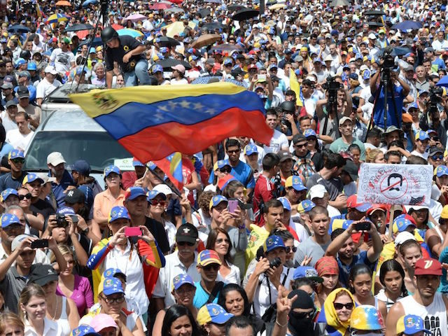 Thousands of opposition activists take part in a demonstration marking 100 days of protests against Venezuelan President Nicolas Maduro in Caracas, on July 9, 2017. Venezuela hit its 100th day of anti-government protests on Sunday, one day after its most prominent political prisoner, Leopoldo Lopez, vowed to continue his fight …