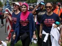 Activist Linda Sarsour (C) and fellow gun-control activists participate in a march beginning at the headquarters of National Rifle Association July 14, 2017 in Fairfax, Virginia. Women's March holds a two-day rally and march from the NRA headquarters to the Justice Department in Washington, DC, to protest the association's 'incendiary and racist actions.' (Photo by Alex Wong/Getty Images)