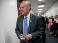 FILE - In this March 28, 2017 file photo, House Government Operations subcommittee Chairman Rep. Mark Meadows, R-N.C. walks on Capitol Hill, in Washington. Members of Congress blasted the Education Department over $6 billion in improper payments made as part of the federal student aid programs. Meadows was adamant that …