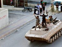 ISIS Islamic militants riding a Soviet-built BMP personnel carrier in Iraq.