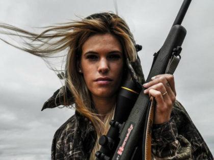 Huntress Melania Capitan with gun