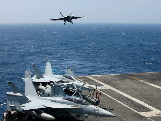 FILE - In this March 3, 2017 file photo, a U.S. Navy F18 fighter jet lands on the U.S. Navy aircraft carrier USS Carl Vinson (CVN 70) following a patrol off the disputed South China Sea. The USS Carl Vinson, which is steaming through the South China Sea, is just …