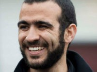 This May 7, 2015, file photo, shows former Guantanamo Bay prisoner Omar Khadr speaking to media outside his lawyer Dennis Edney's home in Edmonton, Alberta. A federal judge in Utah has awarded a $134.2 million default judgment in a lawsuit filed on behalf of two American soldiers against Khadr, a Canadian man who pleaded guilty to committing war crimes when he was 15. (Jason Franson/The Canadian Press via AP, File) MANDATORY CREDIT