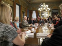 Vice President Mike Pence, left center, speaks to a group of grassroots organizations calling on the Senate to take action on health care legislation, during a meeting in the Eisenhower Executive Office Building on the White House complex, Friday, July 21, 2017, in Washington. (AP Photo/Alex Brandon)