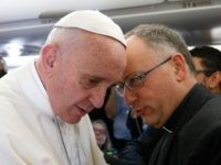 Pope Francis talks with Jesuit Father Antonio Spadaro, editor of La Civilta Cattolica, while meeting journalists aboard his flight to Havana Feb. 12. Traveling to Mexico for a six-day visit, the pope is stopping briefly in Cuba to meet with Russian Orthodox Patriarch Kirill of Moscow at the Havana airport. …
