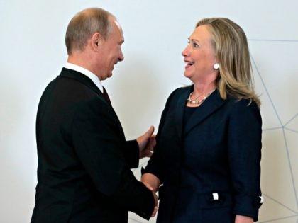 Putin, Hillary Mikhail MetzelAP