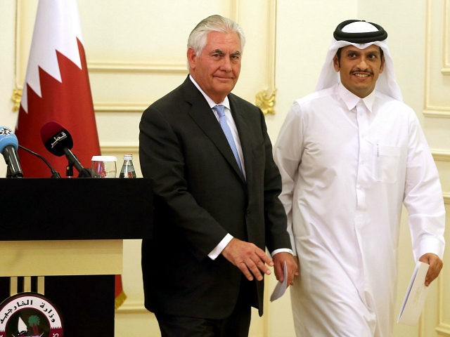 US Secretary of State Rex Tillerson and Qatari Foreign Minister Sheikh Mohammed bin Abdulrahman Al-Thani leave the stage following a press conference in Doha, on July 11, 2017. The US and Qatar announced they have signed an agreement on fighting terrorism, at a time when the emirate is facing sanctions from neighbouring countries which accuse it of supporting extremism. / AFP PHOTO / STRINGER (Photo credit should read STRINGER/AFP/Getty Images)