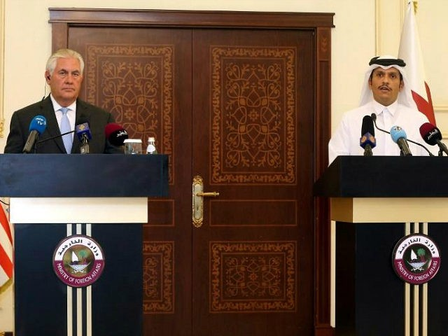US Secretary of State Rex Tillerson and Qatari Foreign Minister Sheikh Mohammed bin Abdulrahman Al-Thani listen to questions by journalists during a press conference in Doha, on July 11, 2017. The US and Qatar announced they have signed an agreement on fighting terrorism, at a time when the emirate is …