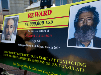 In this March 6, 2012 file photo, an FBI poster showing a composite image of former FBI agent Robert Levinson, right, of how he would look like now after five years in captivity, and an image, left, taken from the video, released by his kidnappers, in Washington during a news …