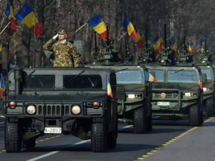 Romanian army forces take part in a military parade to celebrate the National Day of Romania in Bucharest, December 1, 2016.