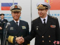KALININGRAD, RUSSIA - JULY 21: Russian Vice-Admiral Alexander Fedotenkov (R) welcomes Chinese Vice-Admiral Tian Zhong as China's missile destroyer Hefei arrives at Baltic city ahead of the 'Joint Sea 2017' on July 21, 2017 in Kaliningrad, Russia. China and Russia hold a naval drill 'Joint Sear 2017' at Baltic Sea from July 22. (Photo by Wang Xiujun/CHINA NEWS SERVICE/VCG)