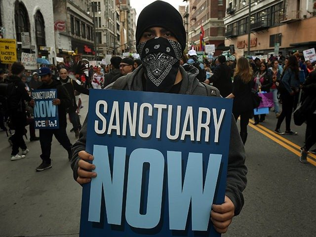 Sanctuary cities, Justice disagree on compliance