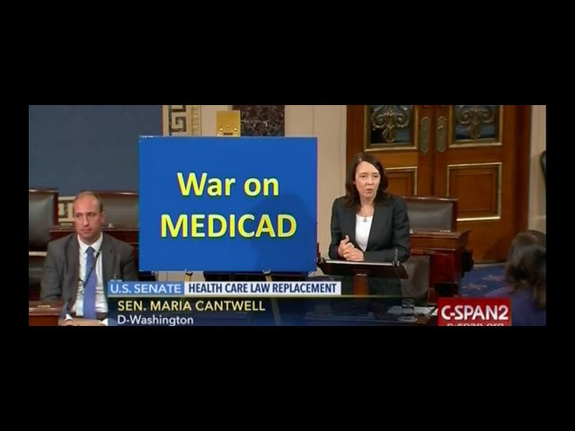 """Democratic Senator Maria Cantwell gave a speech on the Senate floor Tuesday night about expanding Medicaid, all while standing next to a sign that read """"War on MEDICAD."""""""