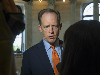 Sen. Pat Toomey, R-Pa. responds to questions on Capitol Hill in Washington, Thursday, May 18, 2017, the morning after the Justice Department appointed former FBI Director Robert Mueller to lead an investigation into President Donald Trump's firing of FBI Director James Comey. (AP Photo/J. Scott Applewhite)