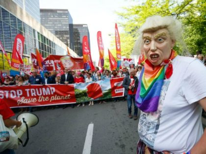 A protester wears a Donald Trump mask mask during a demonstration againt the US president in Brussels on May 24, 2017