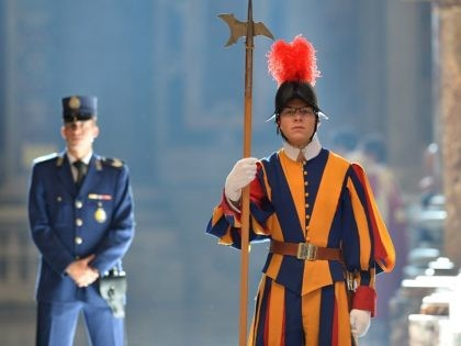 A Swiss guard stands during a papal mass for Cardinals and Bishops who died in the year at St Peter's basilica on November 3, 2014 at the Vatican. AFP PHOTO / ALBERTO PIZZOLI (Photo credit should read ALBERTO PIZZOLI/AFP/Getty Images)