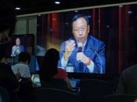 Journalists (in foreground) watch a large video screen showing Terry Gou of the Hon Hai group as he speaks during a shareholders conference at the company's headquarters in Tucheng in New Taipei City on June 22, 2016. Gou, founder of Foxconn parent Hon Hai, spoke at the first shareholders' meeting …