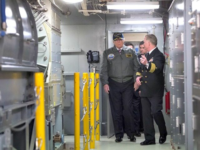 Trump inside aircraft carrier Saul LoebAFP