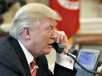 Trump on phone Evan VucciAP